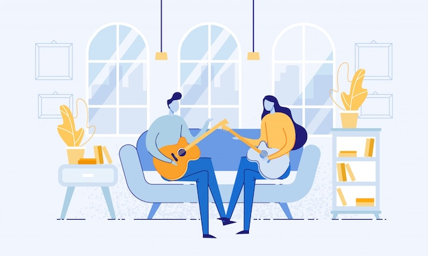 Couple sitting in room on sofa and playing guitar.