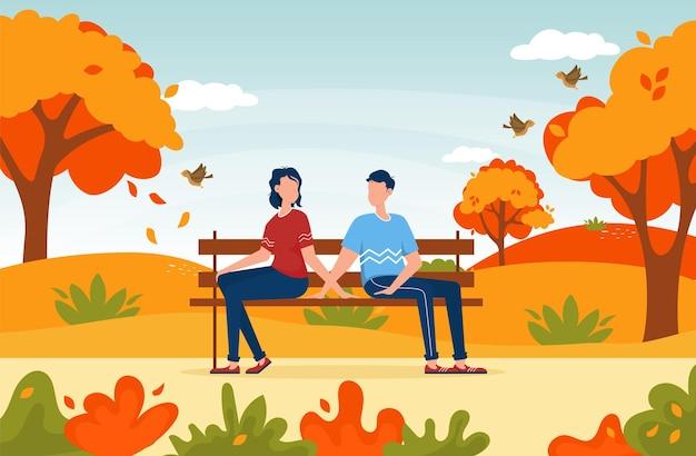 가을 공원에 함께 앉아있는 커플 벤치에 앉아있는 커플