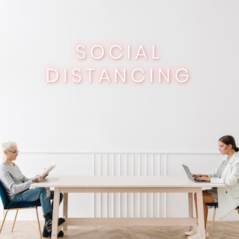 Couple sitting with a social distancing in a house vector