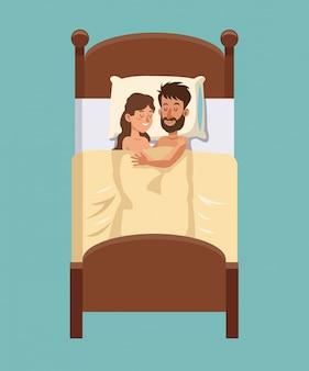 Couple sleeps hugs in bed smiling