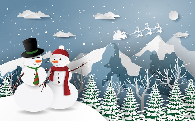 Couple of snowman looking at santa claus snow mountain