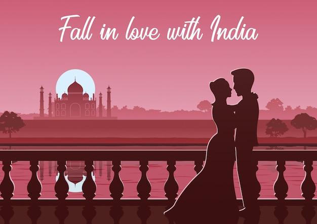 Couple stand near river at taj mahal landmark of india