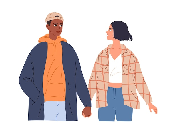 Couple of teenagers in love on a date walk holding hands.