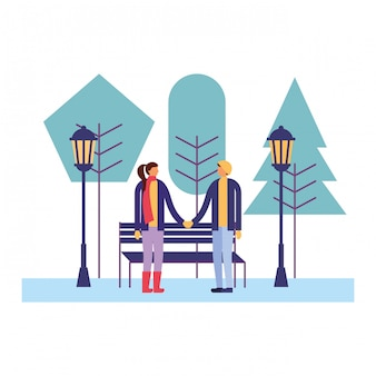 Couple together in the park winter season