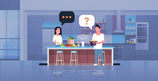 Couple using smart speaker man woman preparing food asking recipe voice recognition concept modern kitchen interior flat horizontal full length