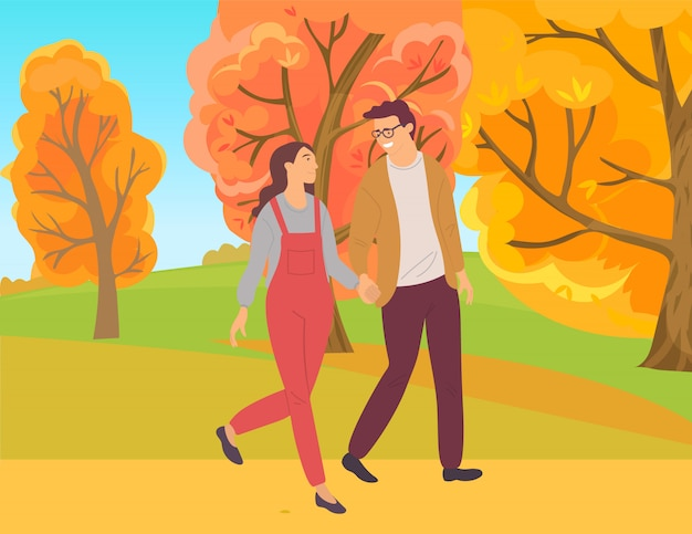 Couple walking in autumn forest, park foliage