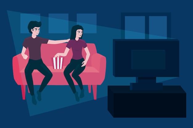 家で映画を見ているカップル