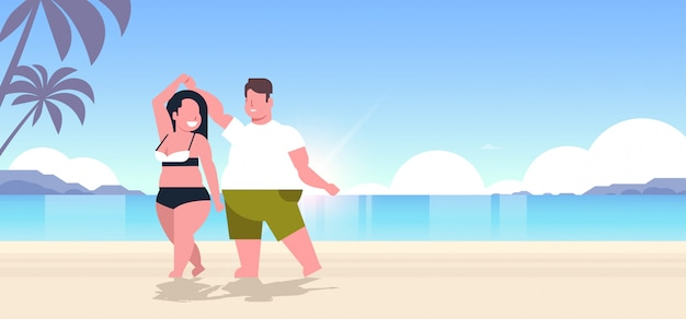 Couple wearing beach clothes  man woman dancing having fun summer vacation concept