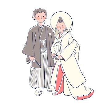 日本の結婚式の服を着ているカップル