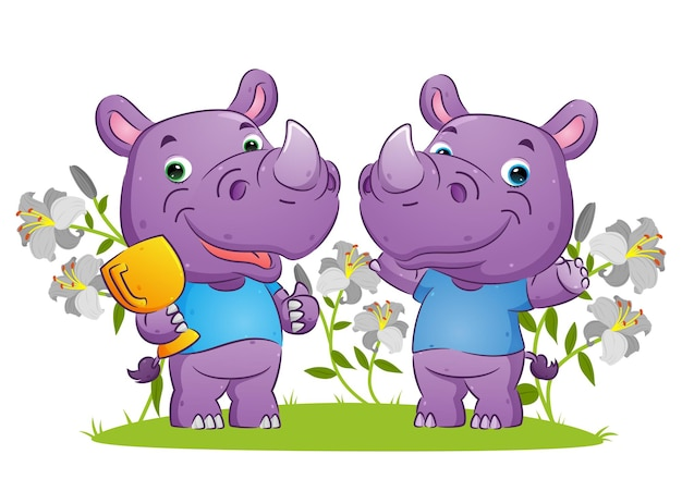 The couple of winner rhino celebrating the victory with holding the trophy  illustration