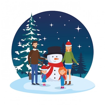 Couple with daughters and snowman in snowscape