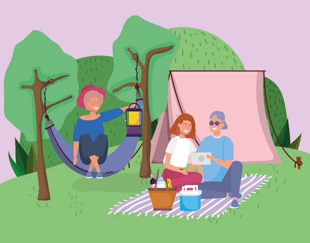 Couple with tablet blanket and woman in hammock tent camping picnic