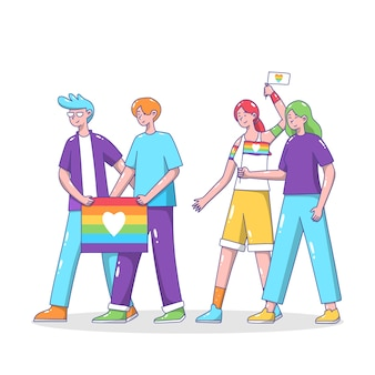 Couples holding pride day flags
