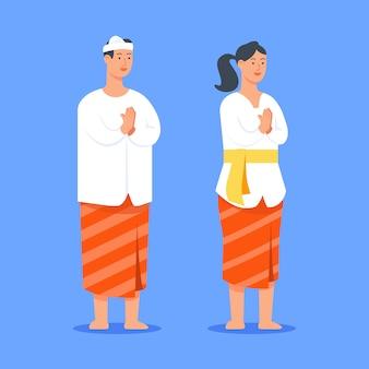 バリのヒンドゥー教の人々のカップルが挨拶をする