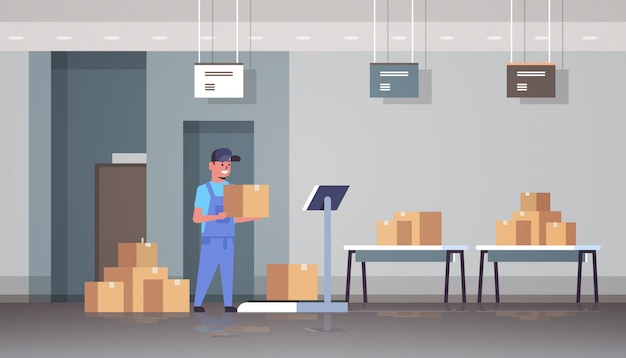 Courier man in uniform putting parcel box on scales mail express delivery logistic service concept modern warehouse interior