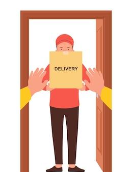 箱を手にした宅配便、商品、食品の無料配達。ドアへの安全な宅配のコンセプト。