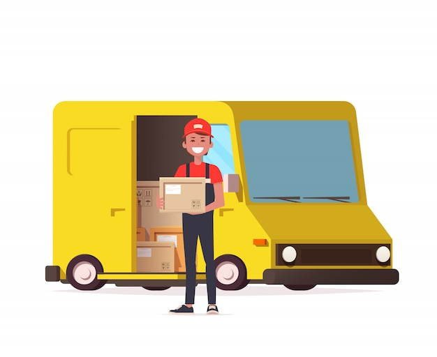 Courier with parcel on the background of a delivery service van