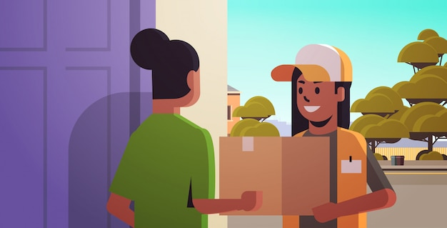 Courier woman delivering cardboard parcel box to girl recipient at home express delivery service