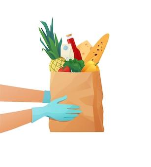 Курьеры в перчатках держат бумажный эко-пакет с продуктами. концепция доставки еды.