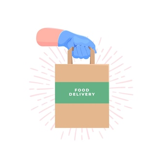 Couriers hand in blue protective rubber glove holding delivery paper bag with food.