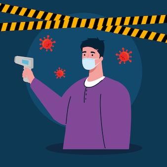 Covid 19コロナウイルス、体温を測定するための赤外線温度計を持つ男