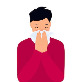 Covid-19. coronavirus symptoms. the boy is coughing behind a napkin. runny nose.