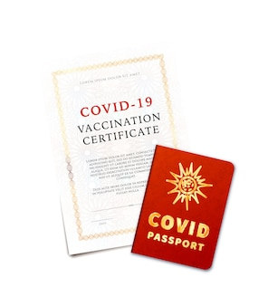 Covid-19 vaccination certificate and passport on white