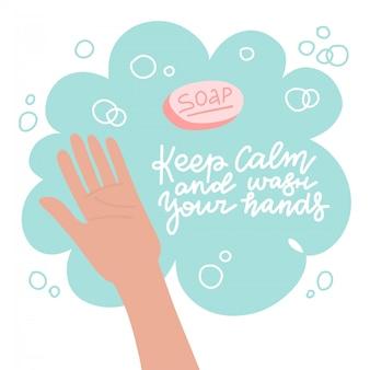 Мытье рук с мылом. способ защиты от распространения коронавируса covid-19. ладонь в мыльной пене. сохраняйте спокойствие и мойте руки - надписи.