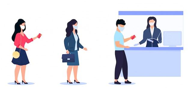 社会的距離とコロナウイルスcovid-19防止。防護マスクをかぶった人々が銀行のレジ係の待ち行列で待っている