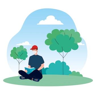 男は屋外で本を読んで、医療用マスクを着て、予防コロナウイルスcovid 19