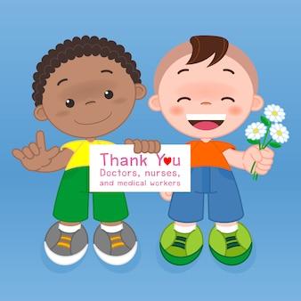 看板を持っている男の子と花をあげるコロナウイルスと闘う病院の医師、看護師、医療従事者に感謝します(covid-19)