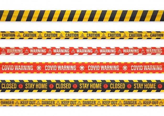 Covid警告。家にいる。閉まっている。白で隔離される別の警告テープ