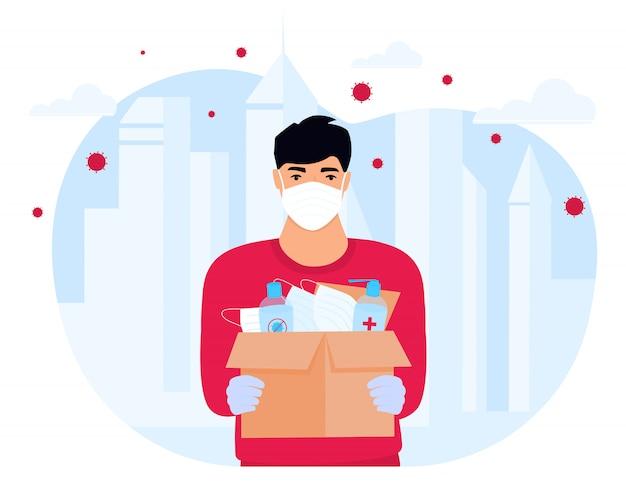 Covid19。人道支援。医療用防護マスクと消毒剤の供給。コロナウイルスエピデミック。小包を配達する配達人