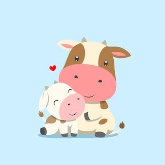 Корова сидит рядом со своей дочерью коровьего детеныша