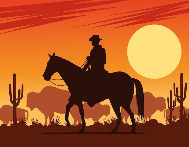 牛と馬の砂漠のシーンでカウボーイフィギュアのシルエット