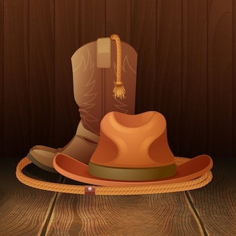 Cowboy hat boots and lasso on wooden background