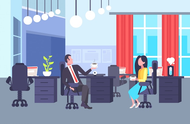 Coworkers couple sitting at workplace colleagues discussing together during coffee break man woman business people talking office co-working center interior horizontal full length