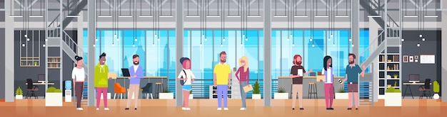Coworking center interior casual people group working together in modern office space