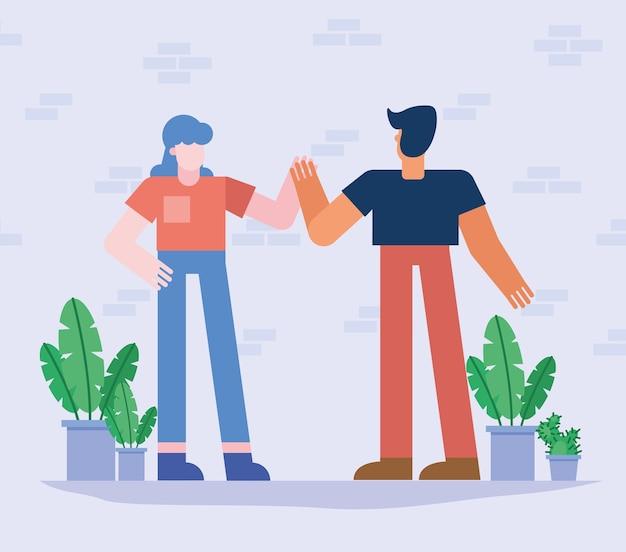 식물을 가진 여자와 남자의 공동 작업