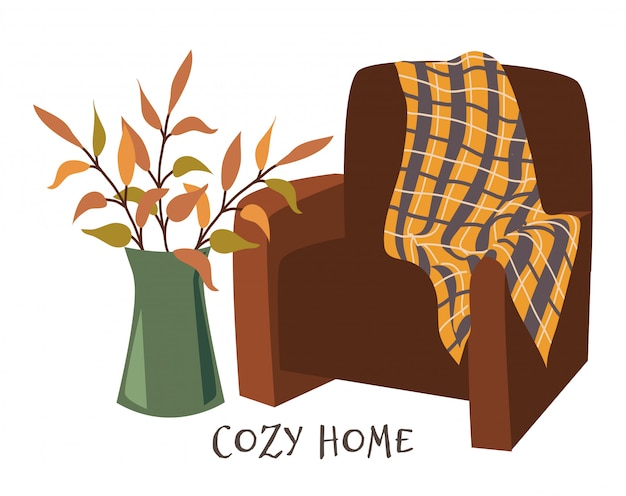 Cozy home. armchair with plaid and branches in vase