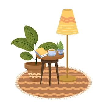 아늑한 휘게 스칸디나비아 구성과 원형 테이블 램프 책 차 꽃