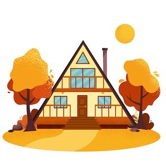 秋の森にある居心地の良い木造の小屋。