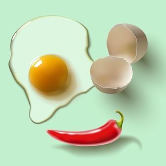 ひびの入った生卵、殻、卵黄、唐辛子