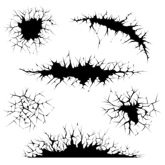 Cracks, cracked ground and wall. Free Vector
