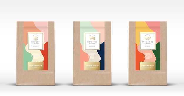 Craft paper bag with nut and citrus chocolate labels set. abstract  packaging design layout with realistic shadows. hand drawn oranges, tangerine and pistachio sketch silhouettes background.
