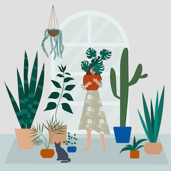 Crazy plant lady in the home garden. a girl hugs a pot with a plant