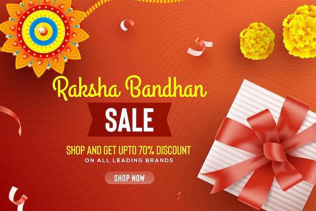 Creative beautiful rakhi gift and flowers onred background for raksha bandhan sale
