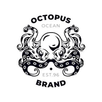 創造的な黒と白のタコのロゴ