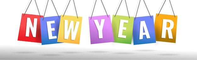 カラフルな紙をぶら下げて新年あけましておめでとうございます2021年の創造的な概念。