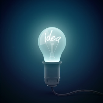 Creative conceptial with glowing light bulb image in a dark room environment with luminant word idea inside illustration